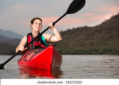 Action Shot of Woman Kayaking