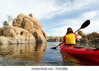 Action Shot of Woman Paddling Kayak in Lake