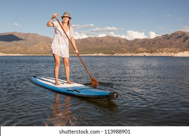 Action Shot of Young Woman Paddleboarding