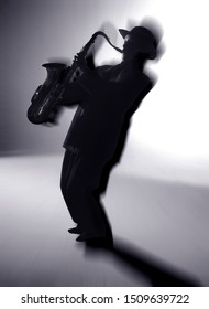 Action Silhouette Of Saxophone Player