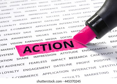 Action word highlighted with marker on paper of other related words. For direction of business strategy success concept
