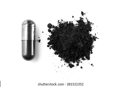 Activated charcoal capsule and powder isolated on white
