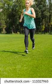 An active beautiful caucasian woman running outdoor in a park