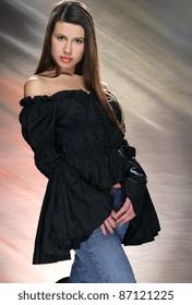 active, beautiful girl in the studio shooting