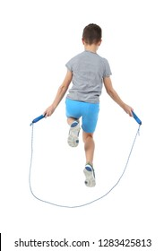 Active boy jumping rope on white background