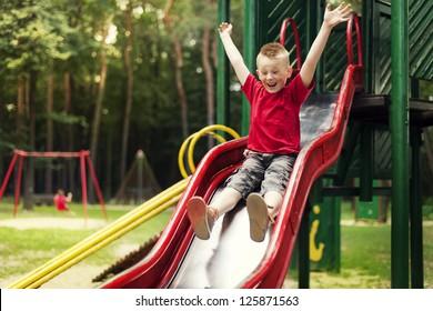 Active boy sliding down