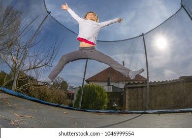 active child jumping on a trampoline