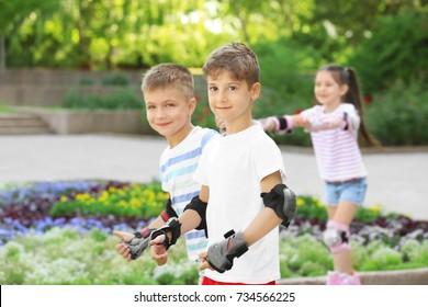 Active children rollerskating in park
