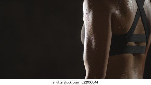 Active Chinese woman lifting dumbbells weights and sweating