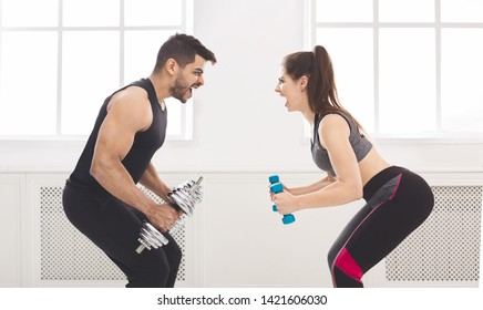 Active couple hardly working out and looking at each other, panorama, copy space