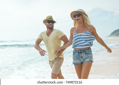 Active couple on the beach