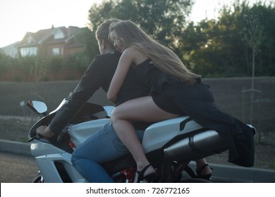 Active couple riding on the motorbike. Adventure concept