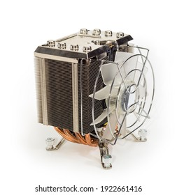 Active CPU cooler with large finned heatsink, fan, copper thermal pad with the heat pipes on a white background, close-up in selective focus