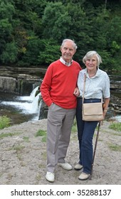 Active devoted senior couple in their 80s  enjoy a day out in the Yorkshire dales, England