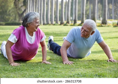Active elderly couple exercising in park