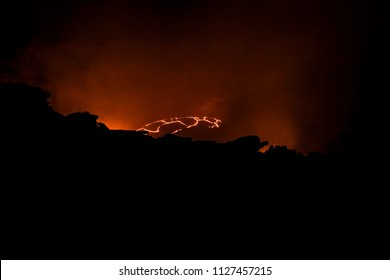 An active Erta Ale volcano at night in Ethiopia that looks like hell