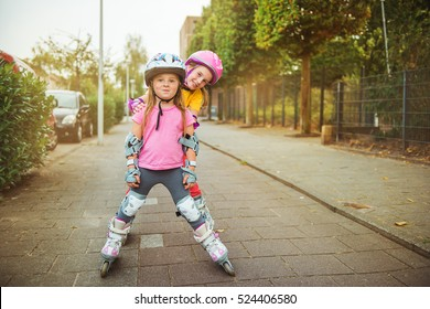Active excited kids trying urban roller skating