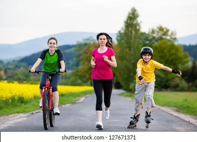 Active family - mother and kids running, biking, rollerblading