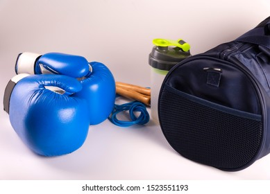 active fitness kit for boxing, boxing gloves, galloping, bandages for hands, cap on a white background, top view.