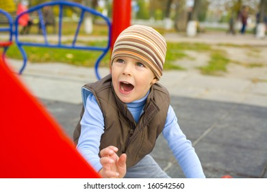 Active four-year-old child playing at a playground