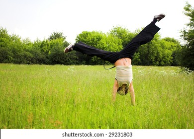 Active girl do cartwheel in park