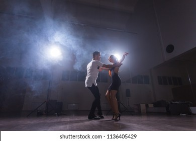 Active happy adults dancing bachata together in dance class