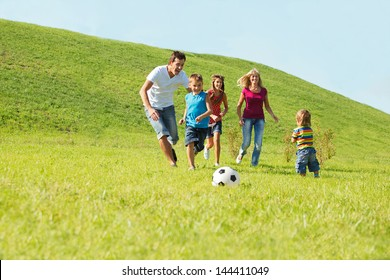 Active happy family playing with a ball