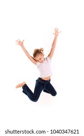 Active happy little girl jumping isolated on white