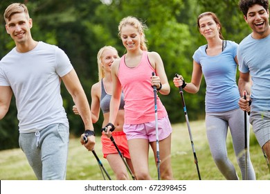 Active and healthy friends nordic walking together in the nature
