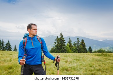 Active healthy man hiking in Alpine mountains