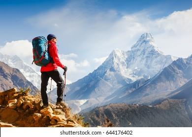 Active hiker enjoying the view. Himalayas. Nepal
