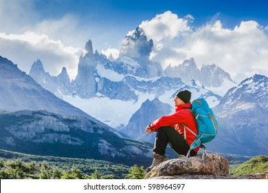 Active hiker enjoying the view, looking at Patagonia mountain landscape. Fitz Roy, Argentina. Mountaineering sport lifestyle concept