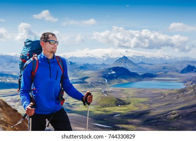 Active hiker enjoying the view on the trail in Landmannalaugar, Iceland