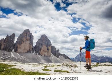 Active hiker enjoying the view. Tre cime di lavaredo national park, south tyrol