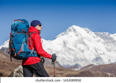 Active hiker hiking, enjoying the view, looking at Himalaya mountains landscape. Travel sport lifestyle concept