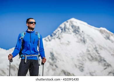 Active hiker hiking, enjoying the view, looking at mountain Himalaya landscape. mountaineering sport lifestyle concept