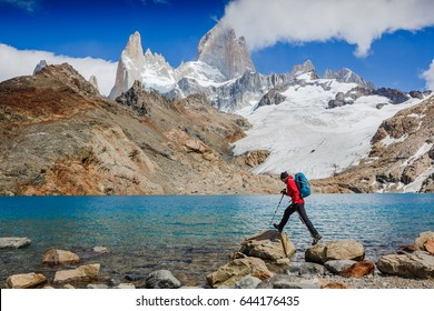 Active hiker hiking, enjoying the view, looking at Patagonia mountain landscape. mountaineering sport lifestyle concept