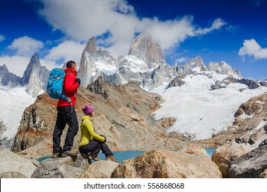 active hikers hiking, enjoying the view of Famous Patagonia mount Fitz Roy Moutain, Argentina