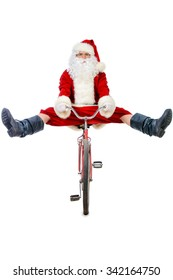Active jolly Santa Claus posing with his bicycle. Isolated over white background. Studio shot. Christmas concept.