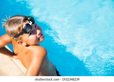 Active lifestyle of Happy boy with goggles in the swimming pool Summer vacation concept