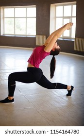 Active lifestyle, healthy spine, flexibility, youth, fitness, yoga concept. Fit woman doing stretching exercise in empty gym