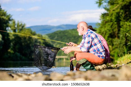 Active lifestyle and hobby. fly fish hobby of men. retirement fishery. Two male friends fishing together. big game fishing. happy fishermen friendship. retired dad and mature bearded son.