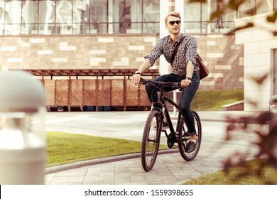 Active lifestyle. Pleased male person wearing sunglasses while spending time outdoors
