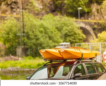 Active lifestyle sport concept. Car with kayak yellow canoe on top roof ready to transportation