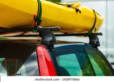 Active lifestyle sport concept. Car with yellow canoe on top roof.