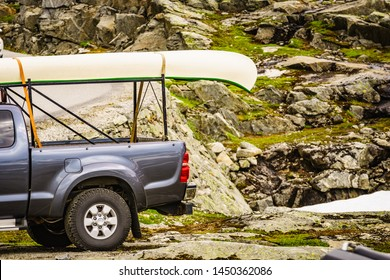 Active lifestyle sport concept. Car with canoe on top roof in mountains