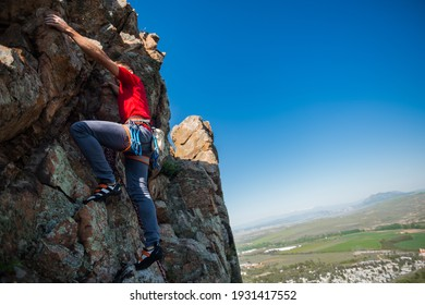 Active lifestyle. Sports in nature. Overcoming a difficult climbing route