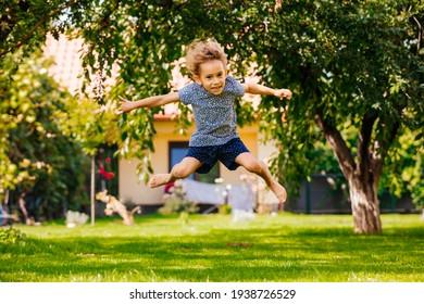 Active little girl has fun on the backyard