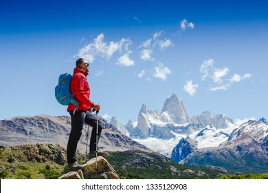 Active man hiking in the mountains. Patagonia, Mount Fitz Roy. Mountaineering sport lifestyle concept
