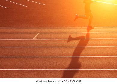 Active man jogging in stadium